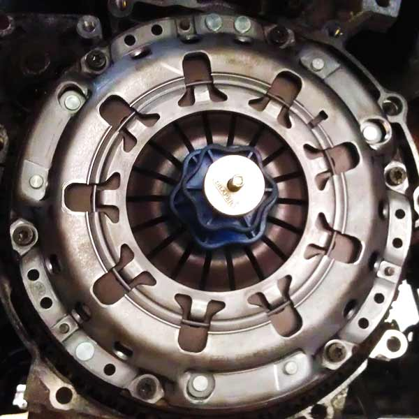 close up of a completed replaced clutch on a ford transit with clutch alignment tool still in