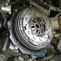 close up of a shiny new clutch fitted to a vauxhall car after the worn out old clutch had to be replaced