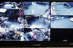 close up of our garages cctv screen showing several camera views of both inside and outside rear of our sheffield garage