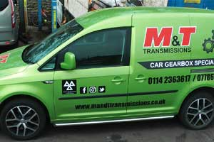 distance side view of our recondtitioned gearbox and differential metalic lime green sign written delivery van