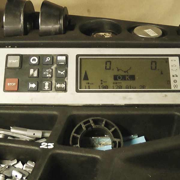 close up view of wheel balancing equipments digital lcd display showing where to add weights to balance the wheel on test